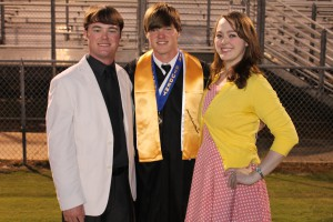 Michael (Middle) Stands with his brother(Mase) and sister(Marika) at his '12 graduation